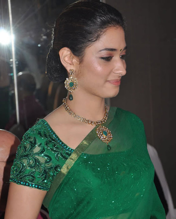 tamannah looking in green saree cute stills