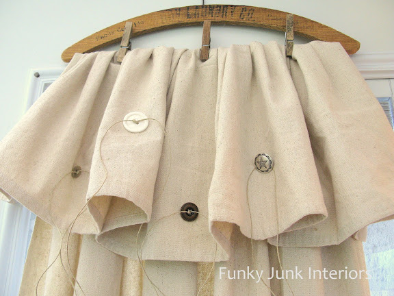 Learn how to make these easy vintage hanger crop cloth curtains as a window treatment with a drop cloth and vintage hanger! Click for the full tutorial.