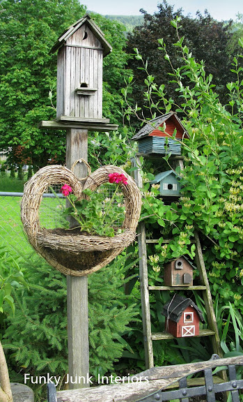 wooden bird houses in the garden on a ladder / FunkyJunkInteriors.net
