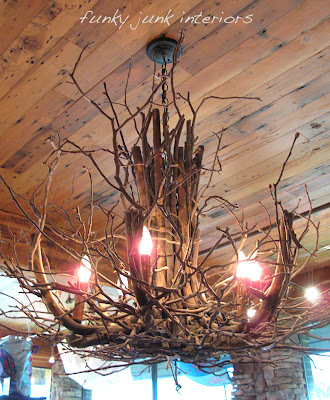 How to DIY a whimsical expensive looking (but FREE) white branch chandelier! It's gorgeous and easy to do! Click for full tutorial. #chandelier #branchchandelier #lighting #diy #rusticdecor