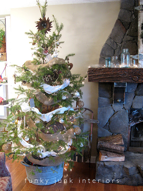 The Whoville Christmas tree with rusty junk ornaments and a metal tub for a tree skirt