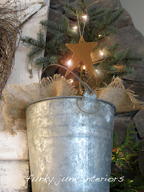 Metal bucket with illuminated charlie brown tree for Christmas