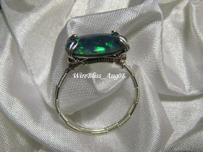 wire wrapped prong ring in sterling silver wire and opal