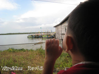 Henry looking out at the boats