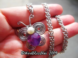 simple wire wrapped butterfly pendant with heart shaped Amethyst