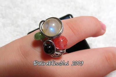 Wire Wrapped Multi gemstone Ring on finger