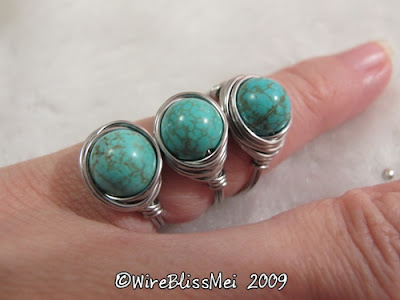 Identical turquoise wire wrapped bird cage ring