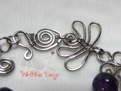 hook and wire wrapped water lily attached to the clasp
