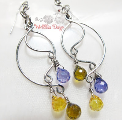 Wire wrapped earrings - Simple three pieces of wires on each side adorned with tear drop glass beads