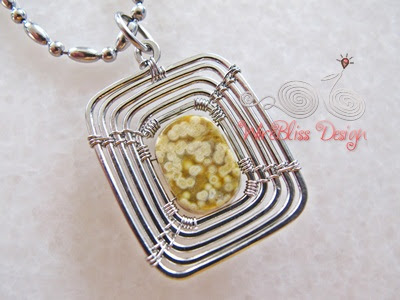 back view of the swirly wire wrap square pendant with square jasper