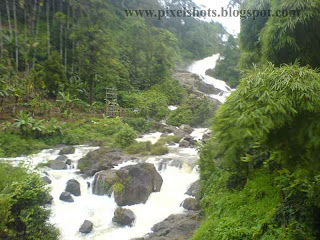 river stream through rocks,water falls scenery on the way to munnar hillstation of kerala,moonar tour trip photos