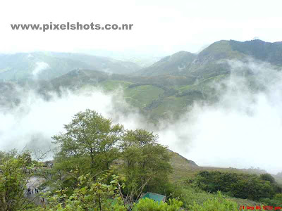 photograph of mist in munnar hillstation kerala,mist moving over mountains in munnar