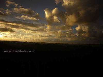 clouds in sunset glowing golden in setting sunlight,photograph of sunset scenery from kerala trivandrum