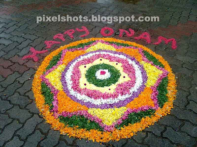 athapookkalam during onam in kerala,flower decorations in onam kerala,athapookalam in onam photographed from a flower laying ,athapookala competition held in kerala