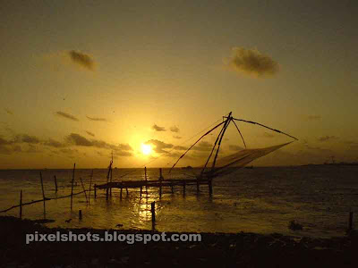fishing nets and sunset,sunset scenery from fort kochi,china fish net in cochin photo,cochin sunset afterglow sceneries