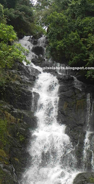 hillstation tour trip photos,waterfalls kerala,monsoon photos of falls,milky water falls,75 feet or 23 metre high waterfalls in idukki kuttikanom,ninnumully falls,river waterfall bathing points in idukki district