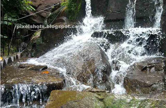 monsoon season rivers in kerala,monsoon mountain stream falls,waterfalls besides kollam thirumangalom nh208,river bathing points besides interstate roads between kerala-tamilnadu