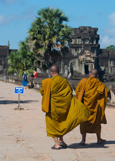 monks at angor wat in orange robes