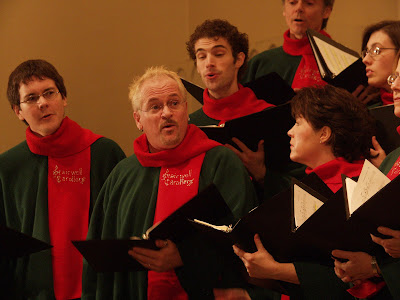 Pierre Massie directs the Stairwell Carollers from within the Tenor section