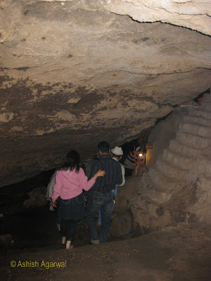 Couple entering the dark cave to reach the Jata Shankar shrine in Pachmarhi