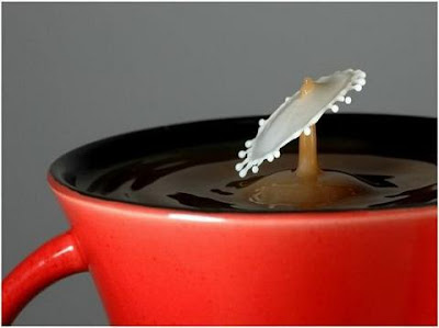 super slow motion picture of cream drops to coffee 13
