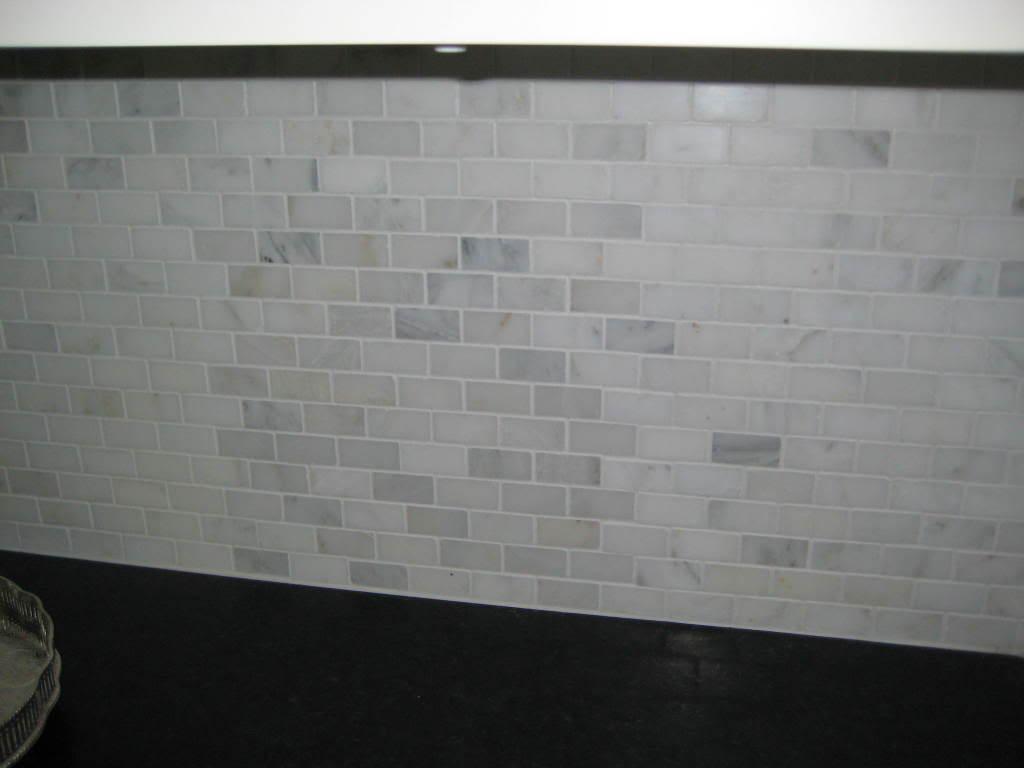 Kitchen Tile Backsplash with White Marble