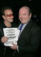 Bono y Paul McGuinness
