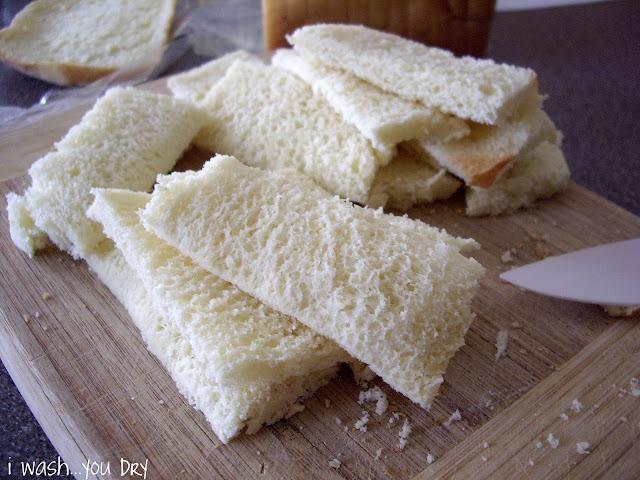 Bread sliced into mini slices.