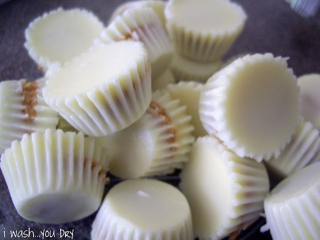 A pile of unwrapped white chocolate peanut butter cups.