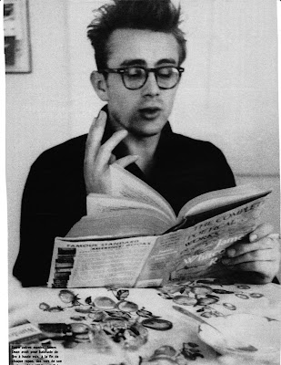 james dean in eyeglasses reading the complete poetical works of James Whitcomb Riley