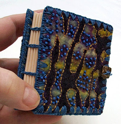 handmade book by Chad Alice Hagen, hand bound, resist-dyed felt cover