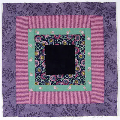God's Eye quilt by Robin Atkins, auditioning fabrics 20