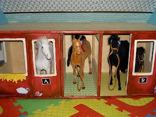 play horses inside painted barn