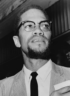 Malcolm X head-and-shoulders portrait, facing right