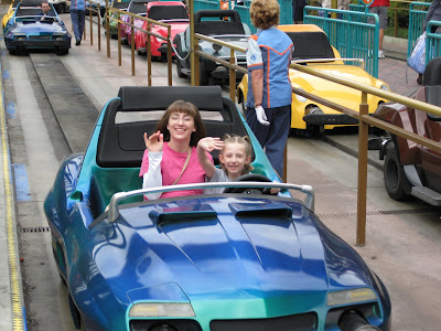 Mommy and Mandi in their Autopia car