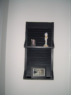 small repurposed shutter shelf