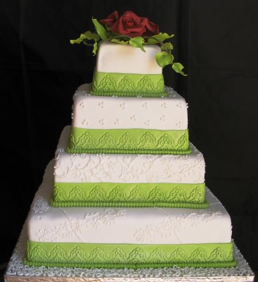 Elegant Multi Tiered White Square Wedding Cake With Green Ribbon T And Fresh Orchids On The Top