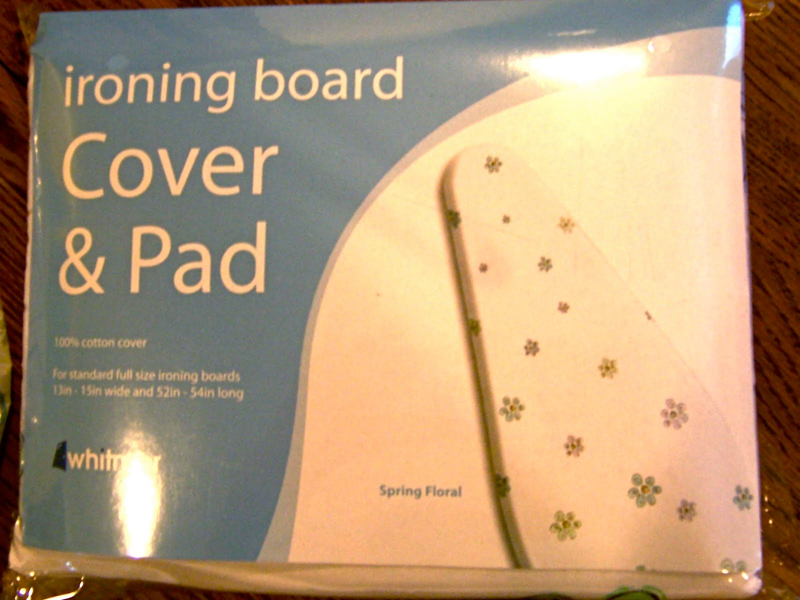 built in ironing board cover and pad
