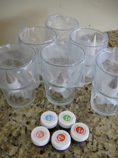 Assemble the bags and food coloring over cups to hold them open.