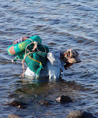 Woman searching for marine products in the sea off Tsunoshima