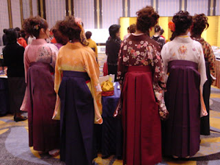 Japanese female university students wearing traditional hakama at their graduation ceremony