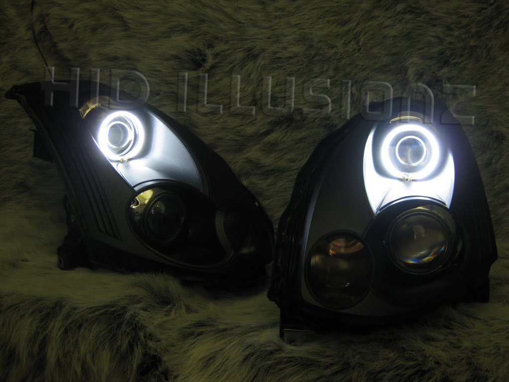 infiniti fx35 bi xenon projectors clear lens color mod conversion gti style shrouds chrome angel eyes white custom fabricated projector turn  [ 1024 x 768 Pixel ]