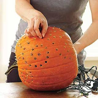 pumpkins with christmas light