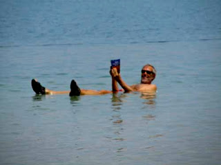 Wayne Dunlap Floating Dead Sea Reading Lonely Planet Guidebook Isreal
