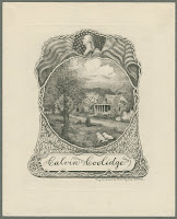 "A bookplate showing an illustration of a home, lawn, and dogs, enclosed in an ornamental and topped by a bust and American flag. Below, the name ""Calvin Coolidge"" is prominently displayed."