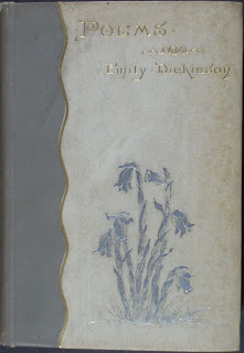 "A cover for Emily Dickinson's ""Poems,"" stamped with a bunch of flowers."