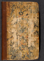 A photograph of the atlas cover, which has a leather spine and marbled boards.