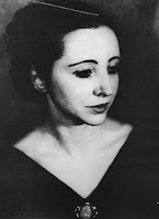 A black and white photograph of Anaïs Nin.