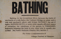 A printed notice prohibiting bathing.