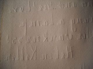 The back of the note, through which the impressions of the letters are strongly pressed.